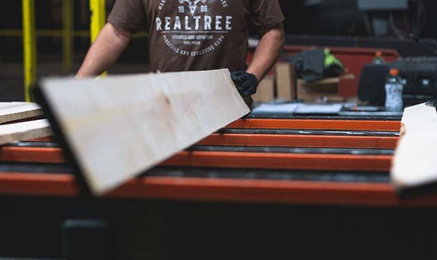 northern hardwoods employee processing wood planks